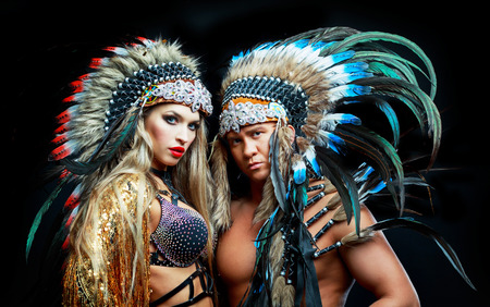 beautiful manand woman, striptease dancers wearing  Native American costumes