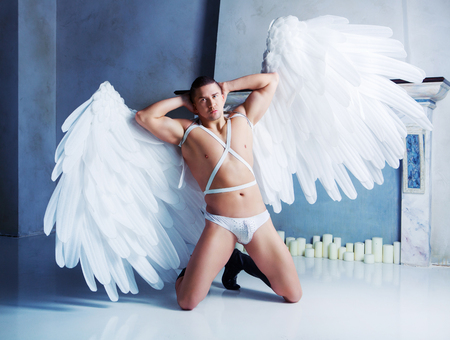 male model with big white angel wings, wearing a dance costume, studio shot Banque d'images - 100290499