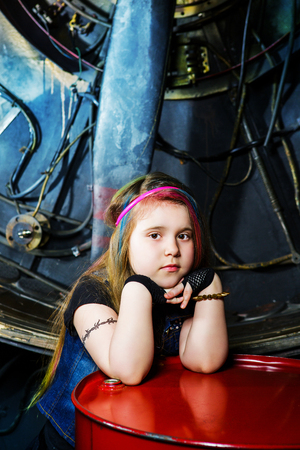 beautiful little girl in the steampunk styled photoshoot in the studio