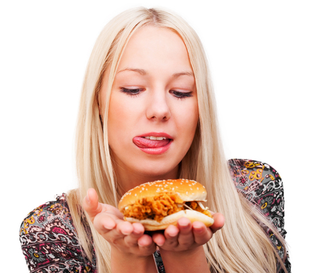 beautiful young blond woman with a burger, isolated against white background