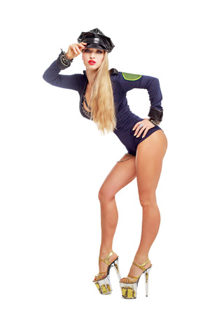 beautiful  striptease dancer, dressed as a police officer isolated against white background