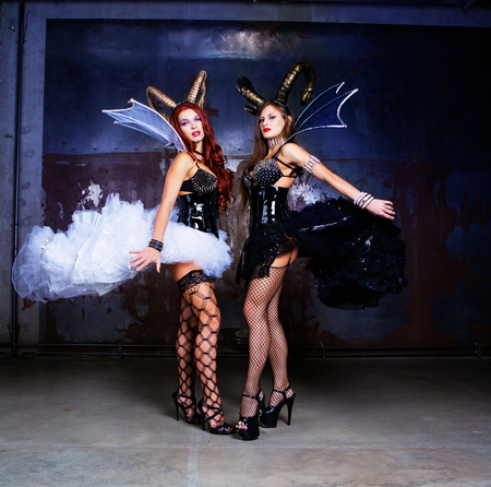 beautiful sexy young models wearing Halloween costume of leather and horns