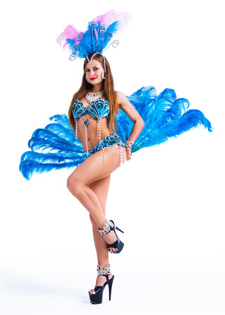 beautiful young woman wearing a Brazilian carnival costume with feathers Stock Photo