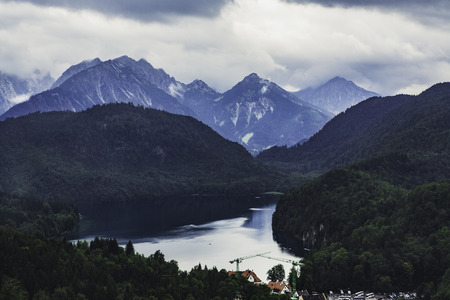 View to the Alpes  from the balcony of the Neuschwanstein castle in Germany in summertime on a coudy day