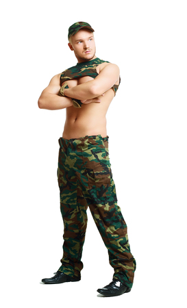 handsome striptease dancer wearing camouflage, against white studio background