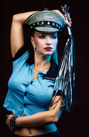beautiful  striptease dancer, dressed as a police officer Stock Photo