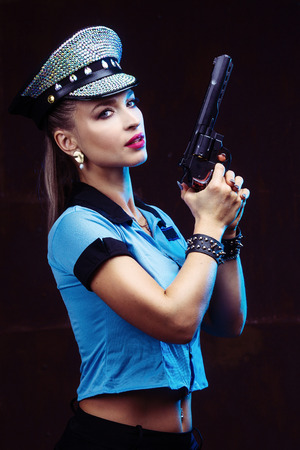 beautiful  striptease dancer, dressed as a police officer Banque d'images