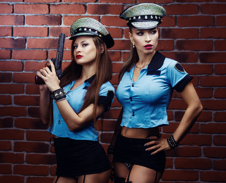 beautiful  striptease dancers, dressed as a police officers Stock Photo