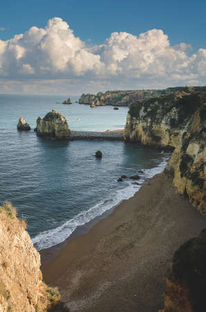 beach among stone cliffs on the shores of the atlantic ocean in the city of Lagos Portugal