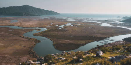 river delta and the town of Dalyan, Iztuzu beach and the surrounding mountains from view point of old town Kaunos. Mugla Province Turkey