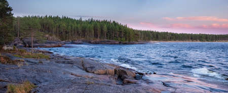 Cape Besov nose in Lake Onega in Karelia in northern Russia at summer sunset Imagens