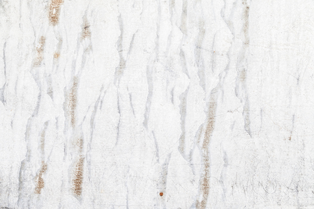 whitewash: cracked old white whitewash with large cracks from time to time