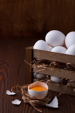 wooden crate: Bunch of fresh white eggs in a wooden crate on a white background Stock Photo