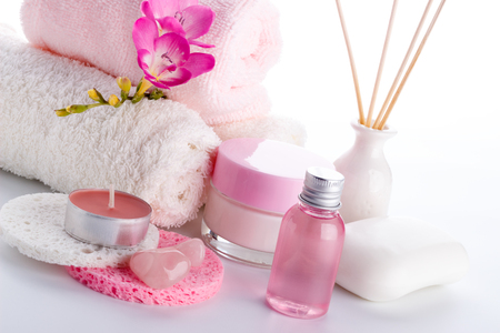 Spa setting and health care items, body lotion,soap,aroma sticks,oil, sponges and towels.