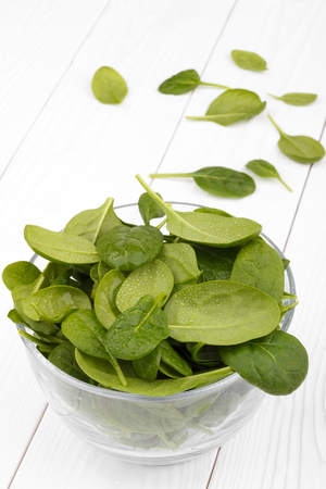 bawl: Spinach in a bawl on white background