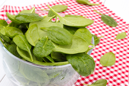 bawl: Spinach in a bawl on red table cloth
