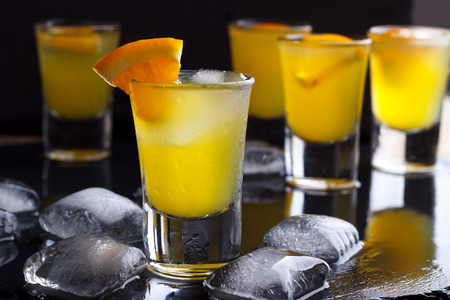 alcohol screwdriver: Cocktail with orange and ice. Alcoholic, non-alcoholic drink-beverage at the bar counter in the night club.
