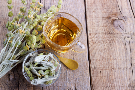 Mountain tea. Sideritis herbal tea and flowers on wooden background,selective focus Stockfoto