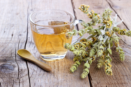Mountain tea. Sideritis herbal tea and flowers on wooden background,selective focus Standard-Bild