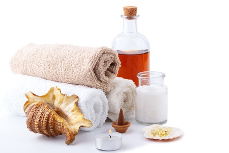 body lotion: Spa setting and health care items,body lotion,bath salt,aroma stick,candle,capsules with oil and towels,isolated on white.