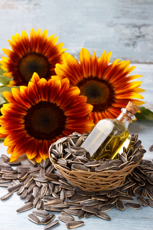 oily: Sunflower Oil with seeds on vintage wooden background Stock Photo