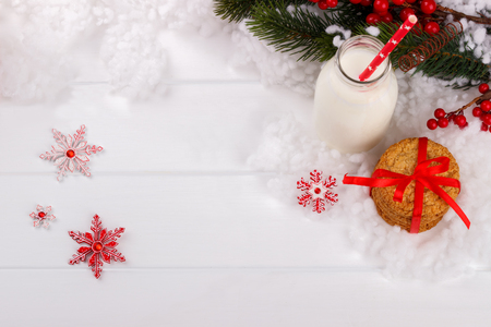 Glass of milk and cookies for Santa Claus, Christmas background