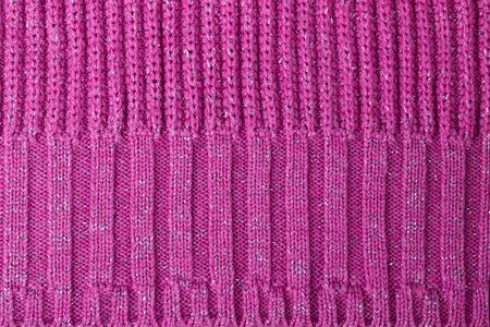 tejido de lana: La textura de color rosa tejido de punto de lana de fondo y de un resumen de antecedentes Foto de archivo
