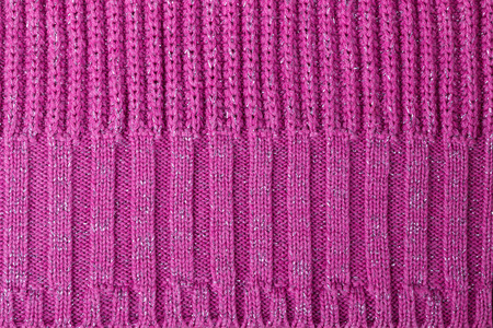 tejido de lana: Texture of pink knitted woolen fabric for wallpaper and an abstract background