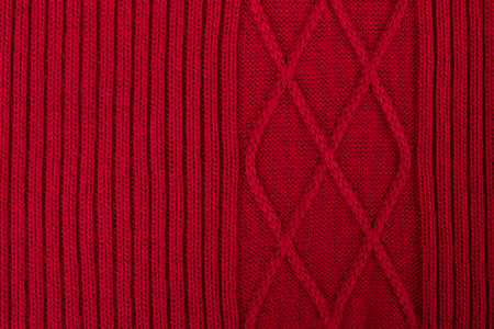 tejido de lana: Texture of red knitted woolen fabric for wallpaper and an abstract background Foto de archivo