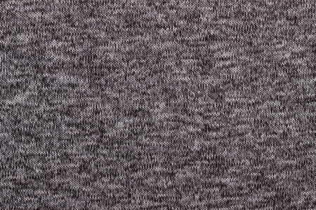 tejido de lana: Texture of gray knitted woolen fabric for wallpaper and an abstract background