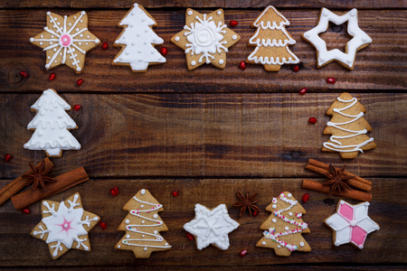 congratulations cards spice: Christmas background with cookies, cinnamon and star anise Stock Photo