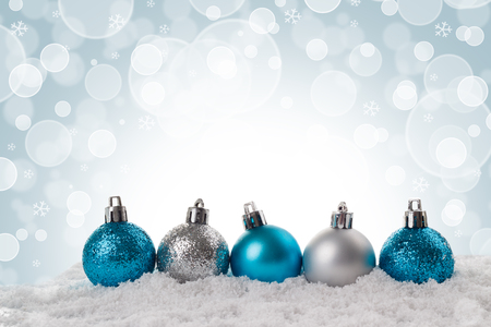 Christmas card small blue and silver balls over blurred background, soft focus