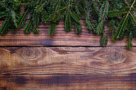 Christmas and New Year background.Fir tree branch on old barn wood. Top view