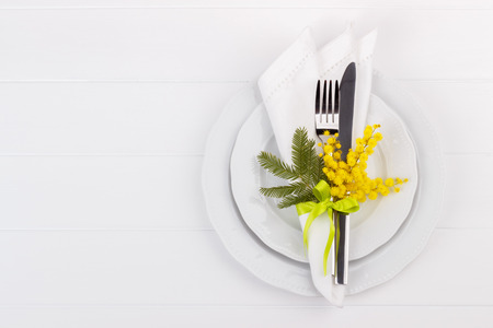 Spring table setting with mimosa. Holidays background with copyspace Stock Photo