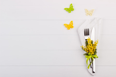 cutleries: Spring table setting with mimosa. Holidays background with copyspace Stock Photo