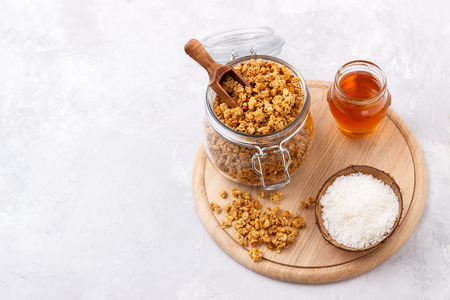 Healthy breakfast with homemade oat and coconut granola on white background