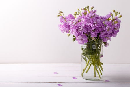 Bouquet Of Lilac Matthiola Flowers In Vase On White Wooden