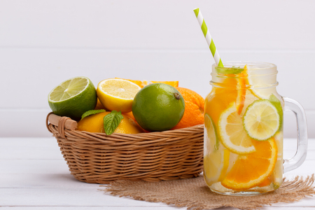Detox fruit infused flavored water. Lemon,lime and orange. Refreshing summer homemade cocktail