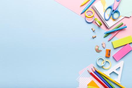 Colorful stationery school supplies on blue trending background, space or text flat lay