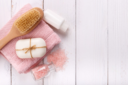Pink Spa setting and health care items on white background. Space for text, flat lay