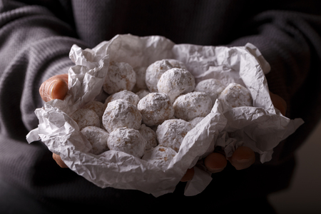 Traditional Christmas cookies with almonds snowball in hands Zdjęcie Seryjne