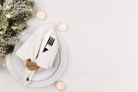 Christmas or new year table setting on white wooden table card or menu template copy space flat lay 免版税图像