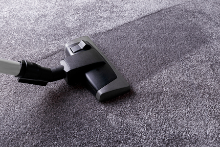 Closeup of vacuum cleaner over grey carpet Stock Photo
