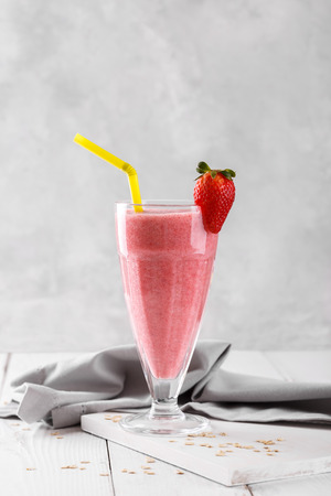 Strawberry smoothie or mikshake in a glass, healthy refreshing drink, vertical Stock Photo