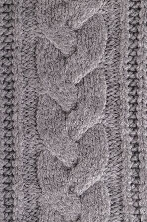 Background texture grey knitted plaid from woolen yarn, cozy winter autumn handmade sweater Banque d'images