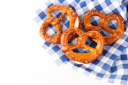 Traditional Bavarian salty pretzels on blue table cloth, close up