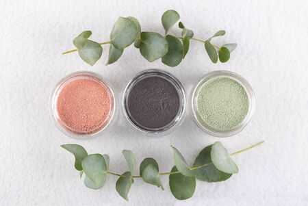 Cosmetic clay powder for skin and hair, spa and wellness, natural cosmetics on white background with copy space