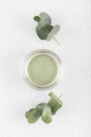 Green cosmetic clay powder for skin and hair, spa and wellness, natural cosmetics on white background 版權商用圖片
