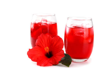 Cold refreshing hibiscus iced ted in a glass with red flower