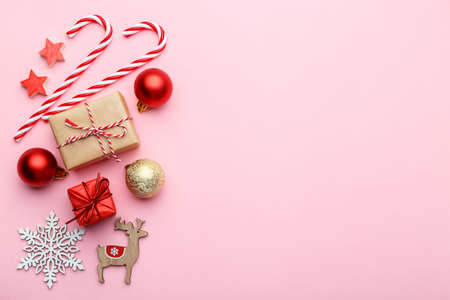 Christmas or new year flat lay, wooden decorations and ornaments on pink background, copy space